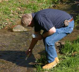 Rick Handshoe taking a water sample