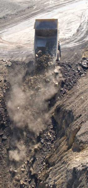 rock truck dumping mining waste in Perry County