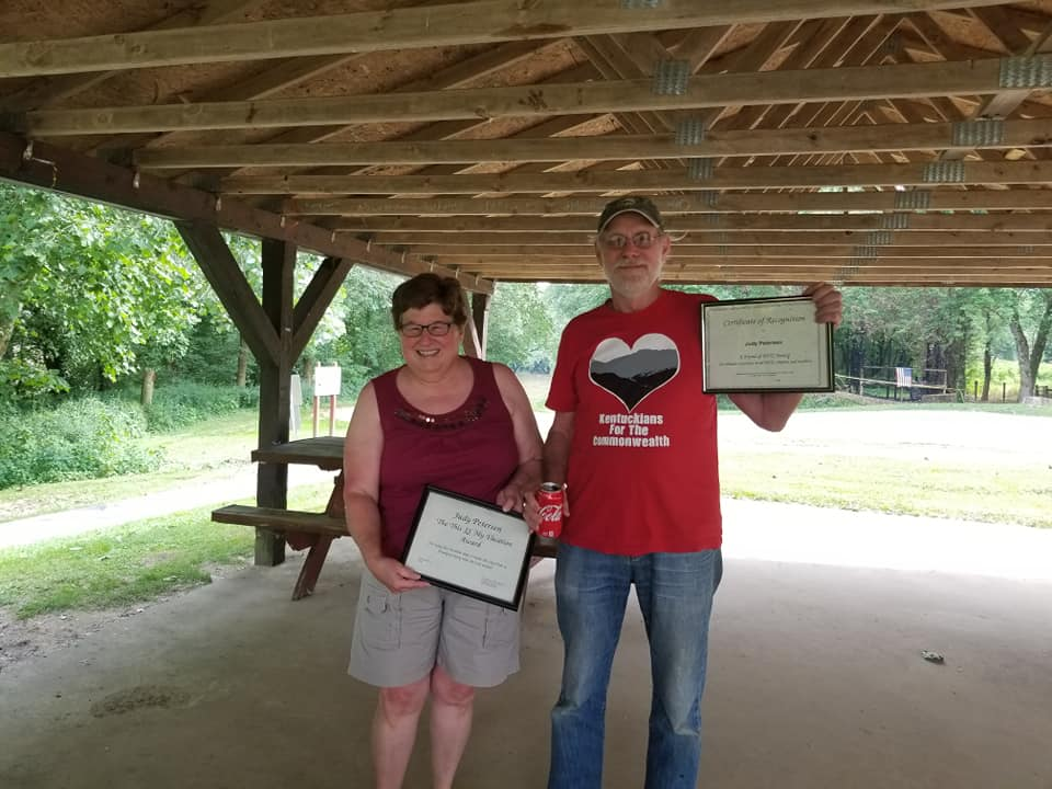 Judy Petersen and Sam Avery holding Judy's KFTC awards for spending time lobbying in Frankfort.