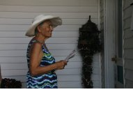 Member Deane Oliva ready to talk taxes in a neighborhood doorway