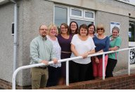From left: After Coal director Tom Hansel, DOVE Workshop Coordinator Lesley Smith, Tanya Turner, Elizabeth Sanders, and DOVE Workshop staff at the former coal board office turned women's education hub in Banwen, Neath, July 2015.