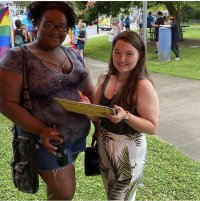 Two people swing by to learn more about KFTC's work at NKY Pride 21!