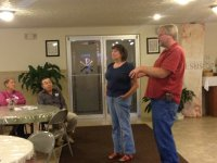 Beverly May and Rick Handshoe speaking to a group from Church of the Epiphany